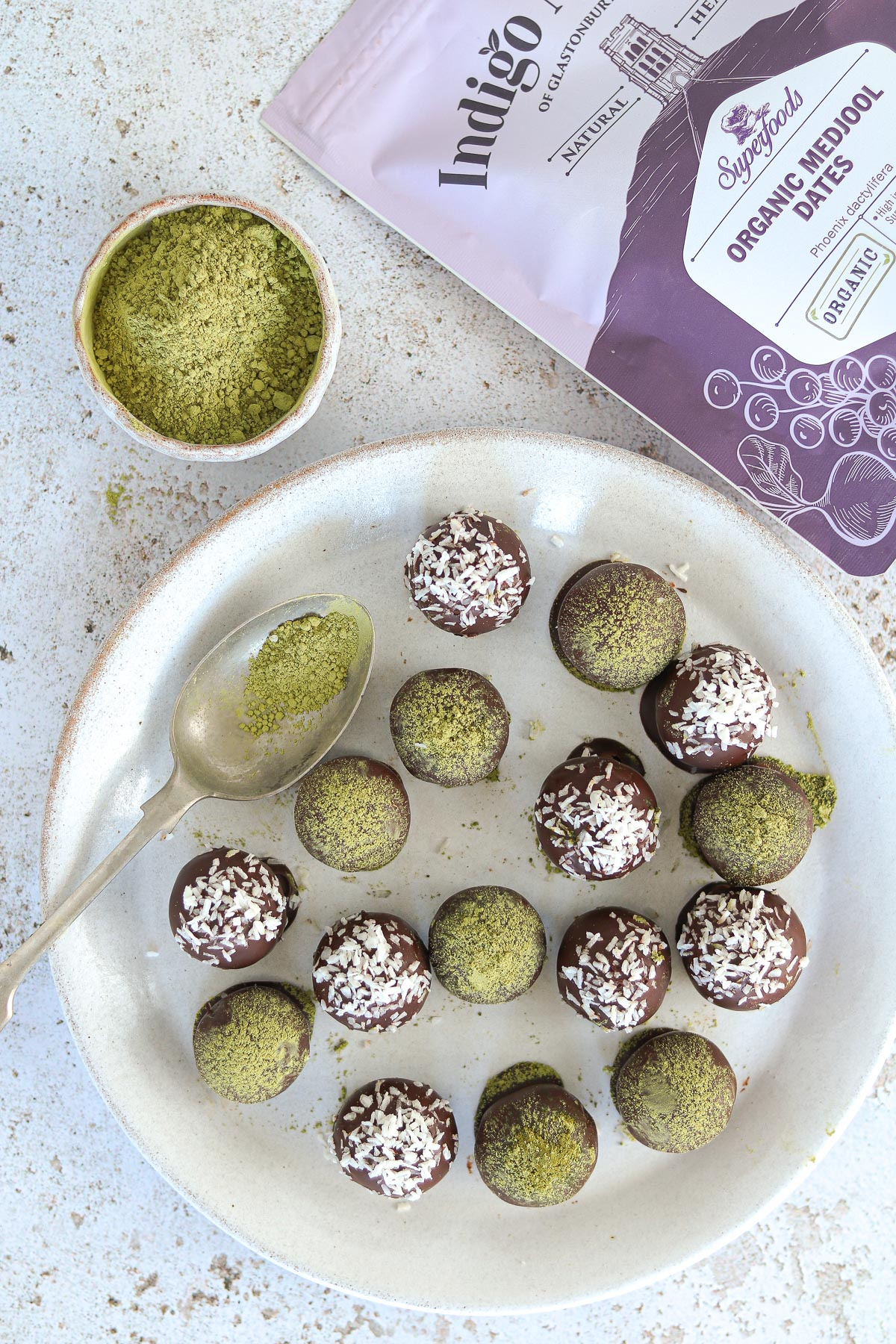 Matcha energy balls on a plate with product