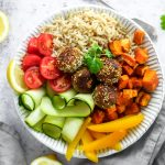 Falafel with sweet potatoes brown rice and salad in a bowl