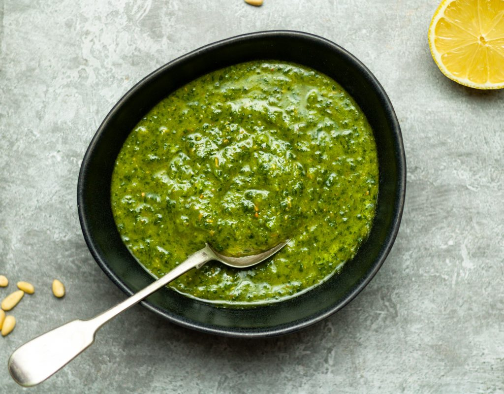 Parsley pesto in a bowl with a spoon