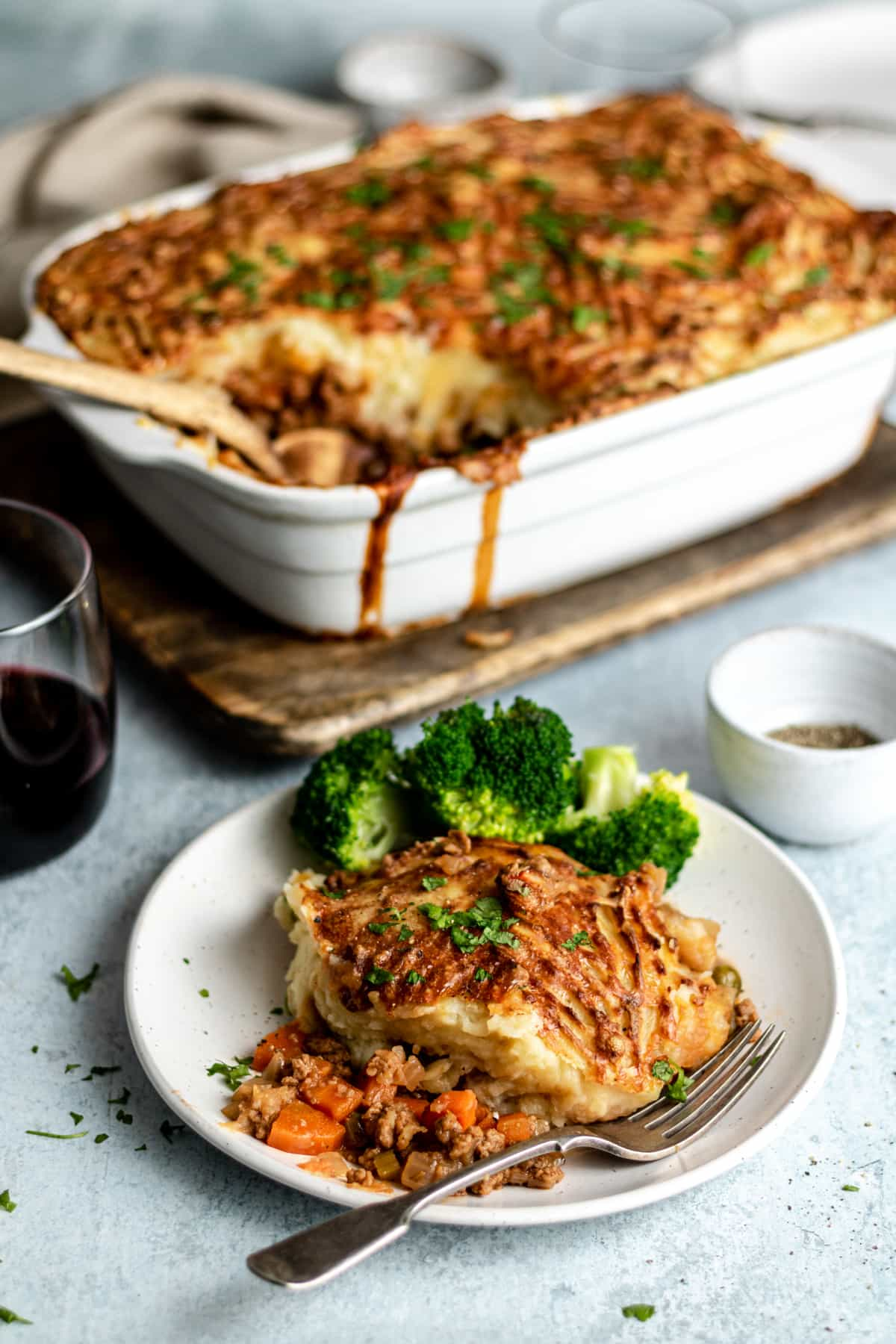 Quorn Cottage Pie with cheesy potato topping plated with broccoli.