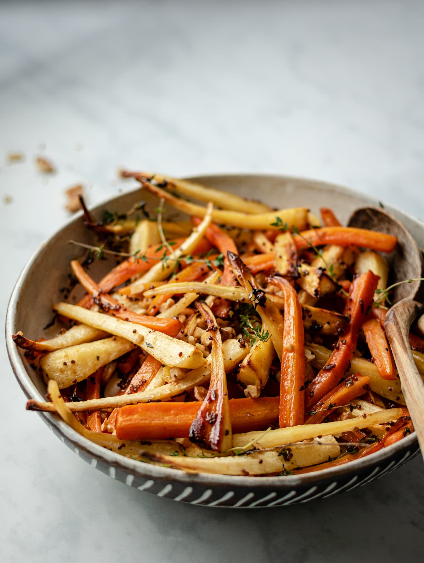 image of serving bowl with roasted carrots and parsnips at 45 degree angle