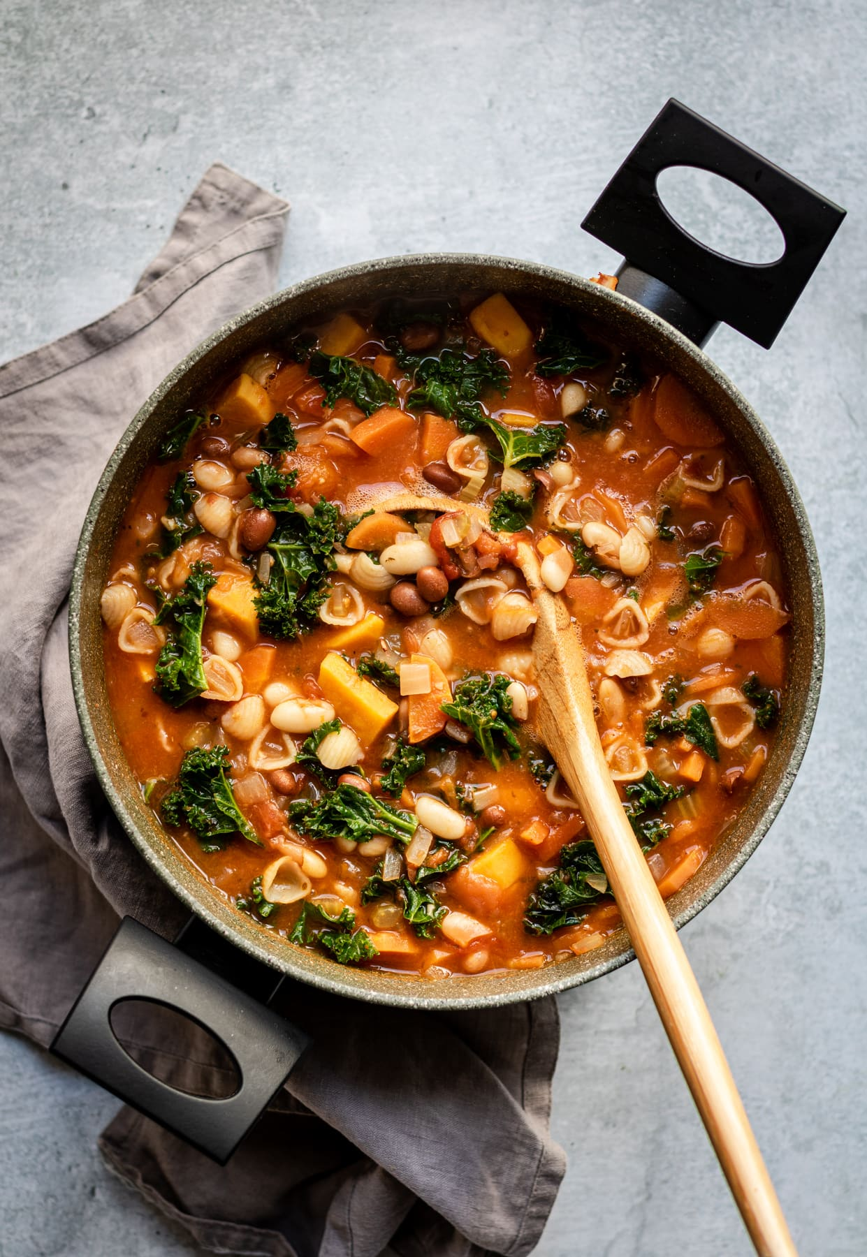Minestrone Soup with beans and kale in stockpot