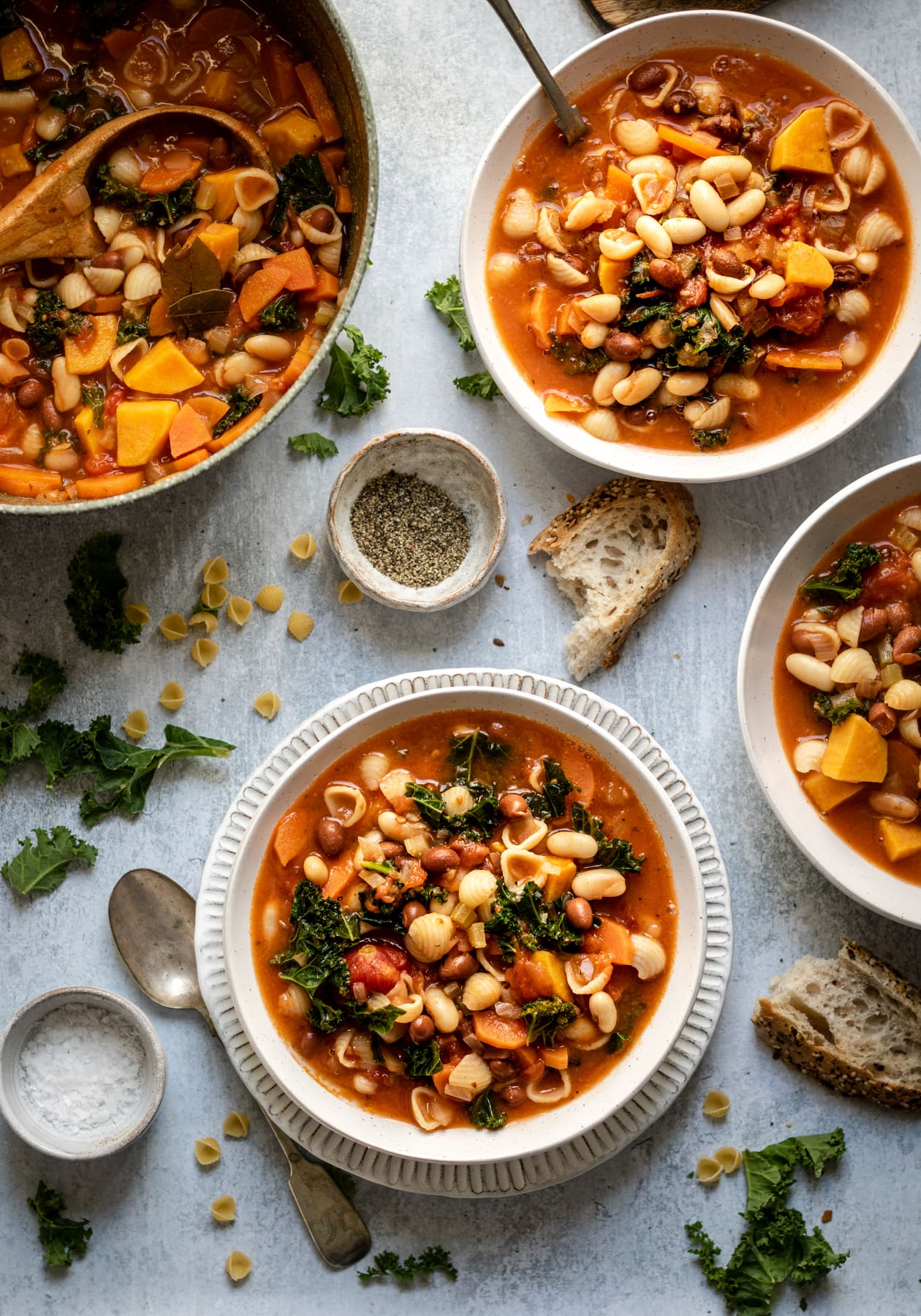 vegetarian minestrone soup with beans and kale in bowls