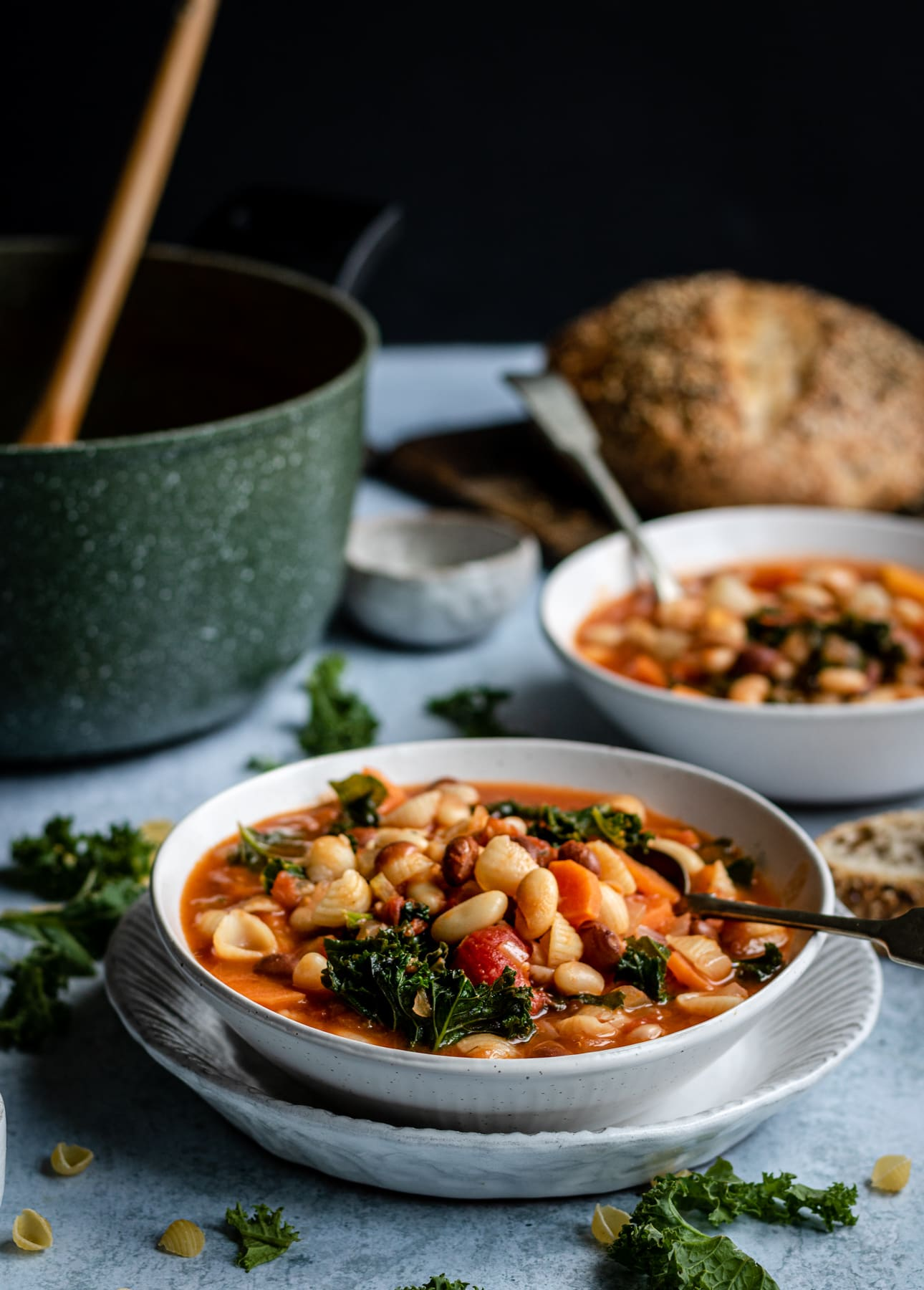 minestrone with kale and beans in bowls with bread