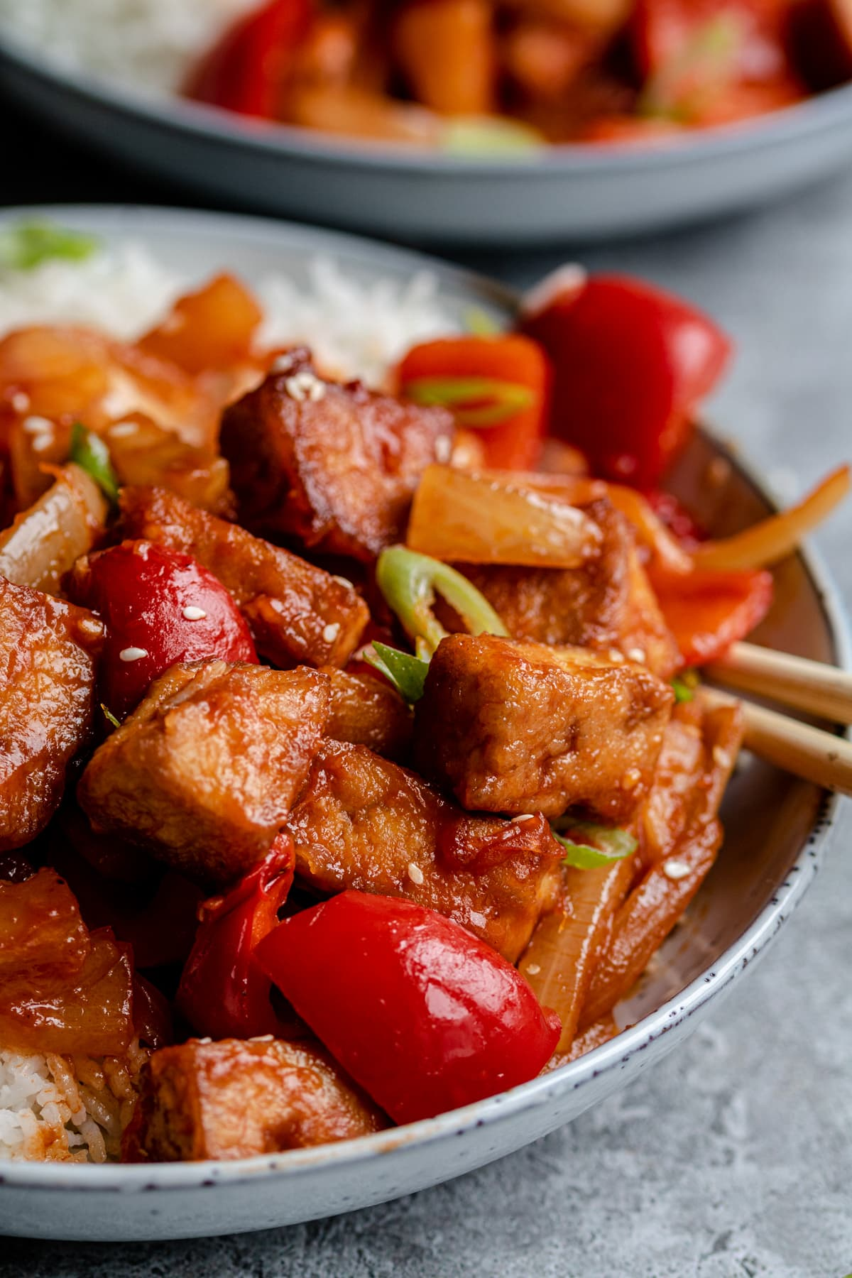 Tofu with onions, red peppers, pineapple chunks, served with white rice