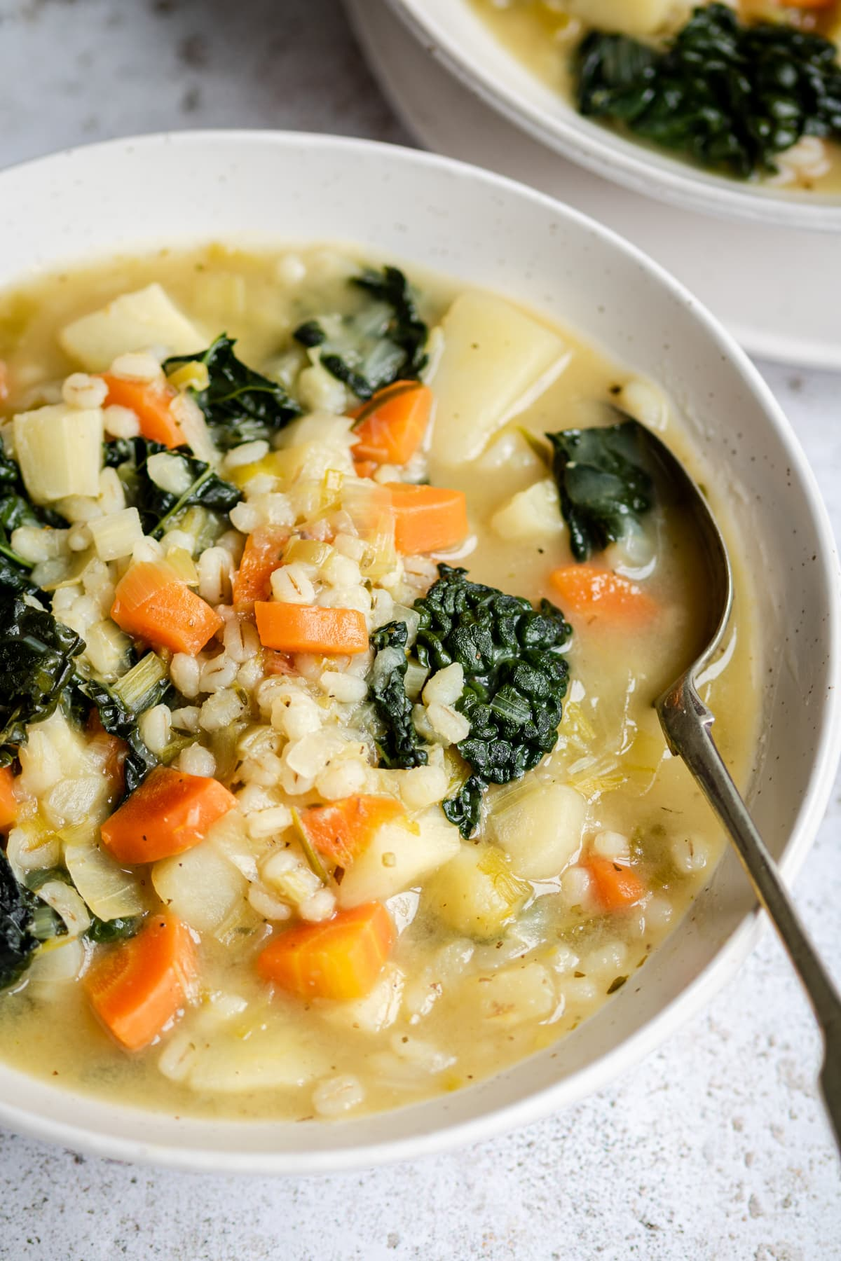 A soup made of potatoes, carrots, celery, parsnips and kale with pearl barley