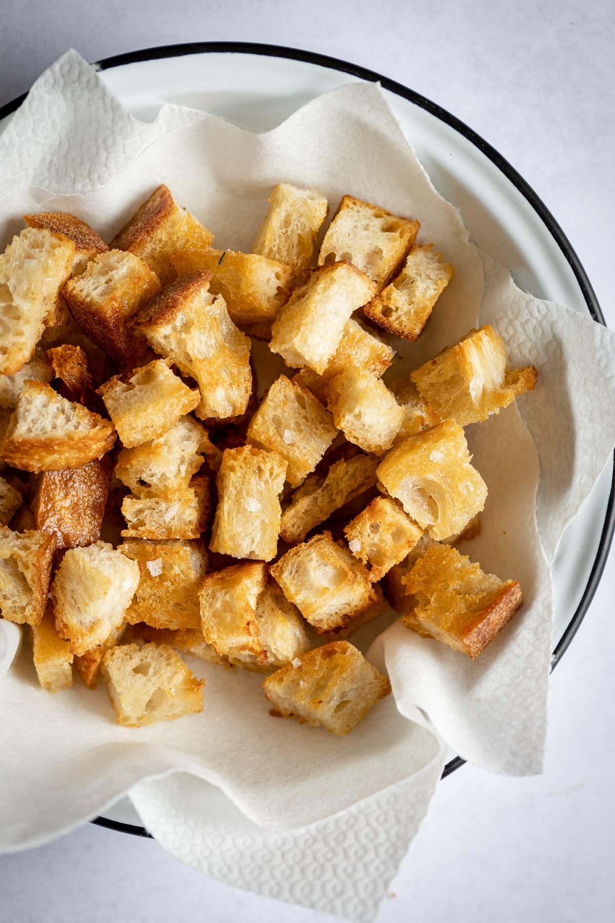 Fried sourdough bread with garlic in a bowl
