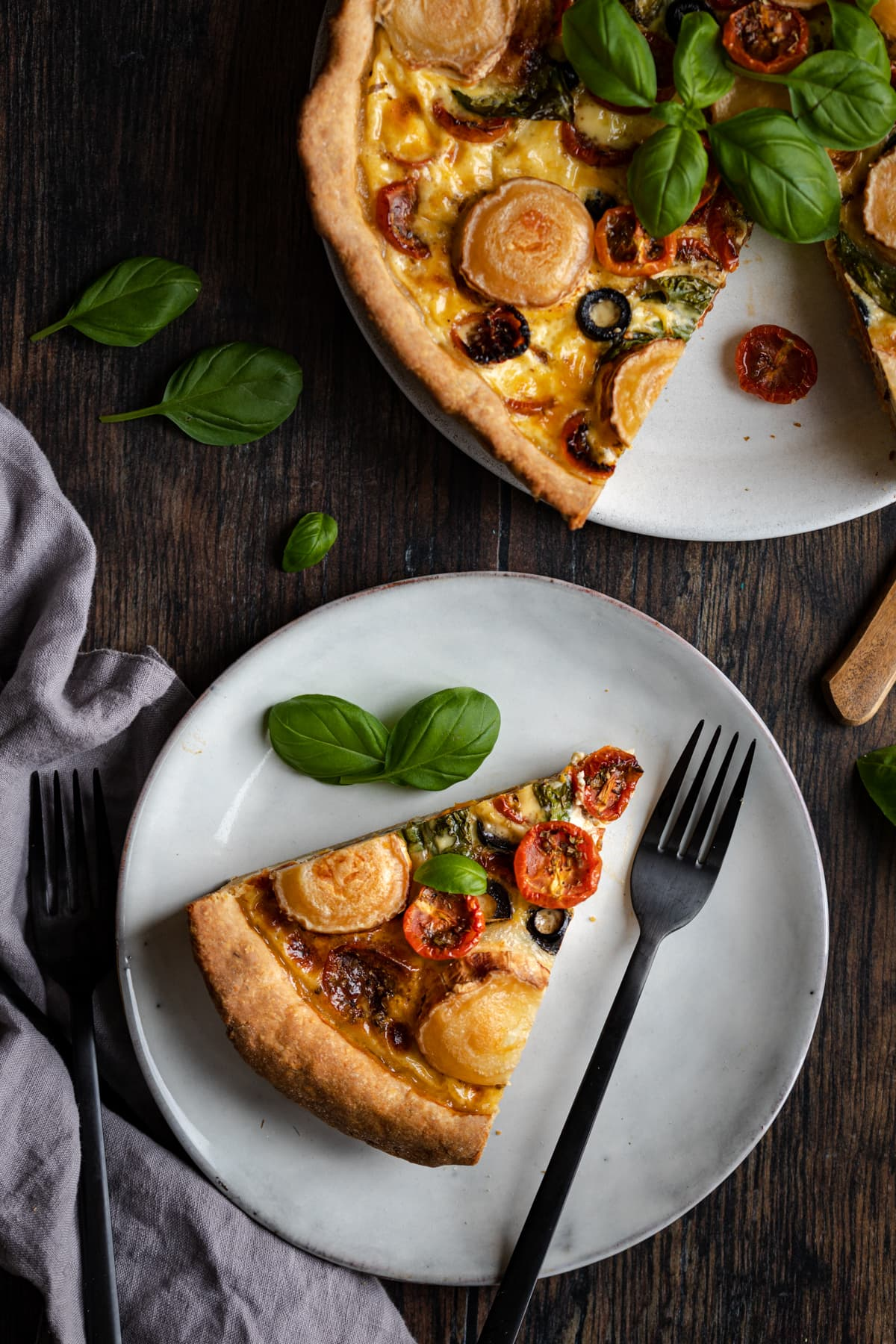 Goats cheese quiche with slow-roasted cherry tomatoes in a flaky homemade pastry.
