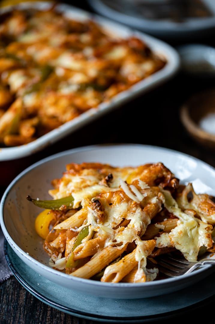 Pasta with vegetables topped with melted cheese