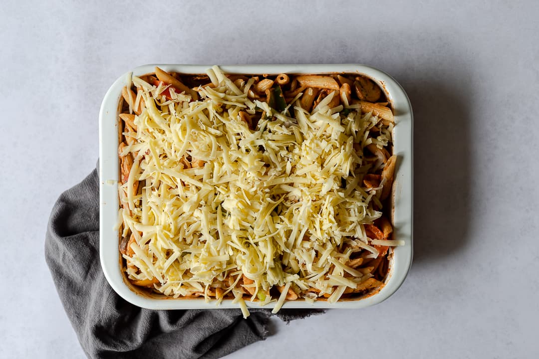 Pasat and vegetables topped with grated cheese