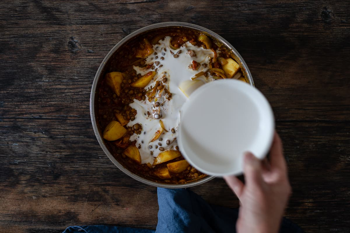 Coconut cream being added to a pan