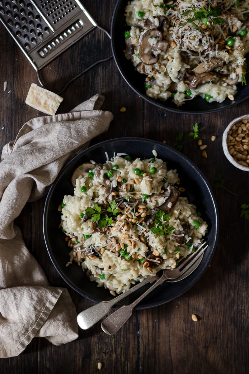 Risotto rice with mushrooms, peas and Parmesan shavings
